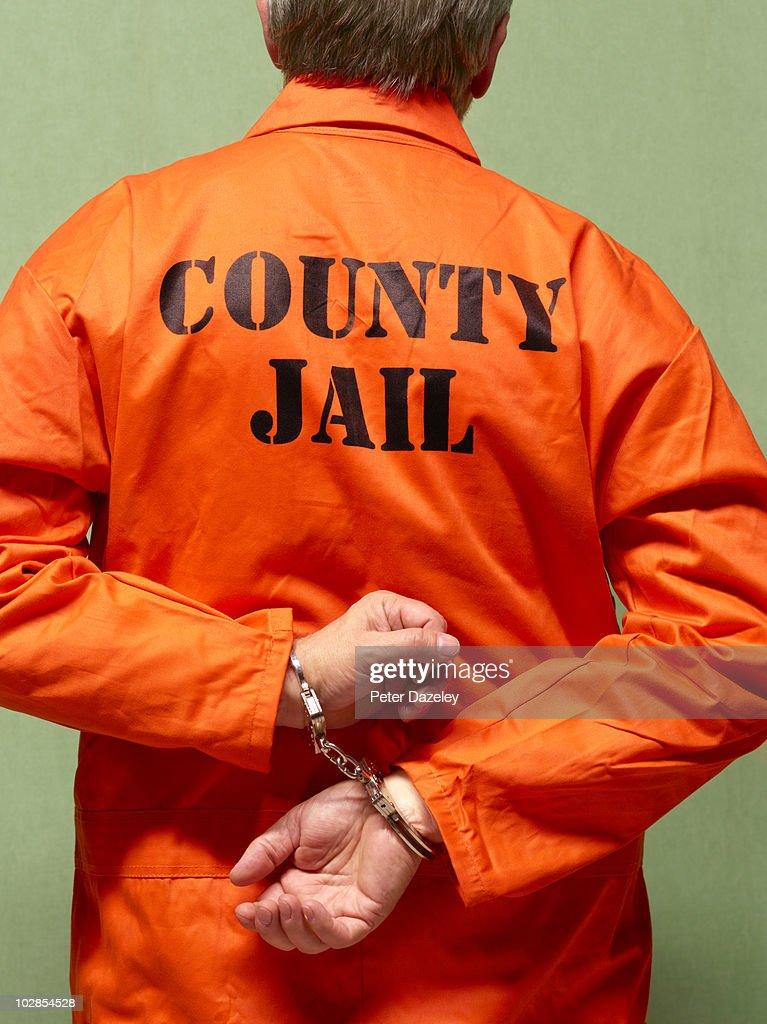 Senior county jail prisoner in hand cuffs