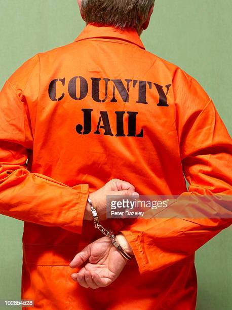 Senior county jail prisoner in hand cuffs