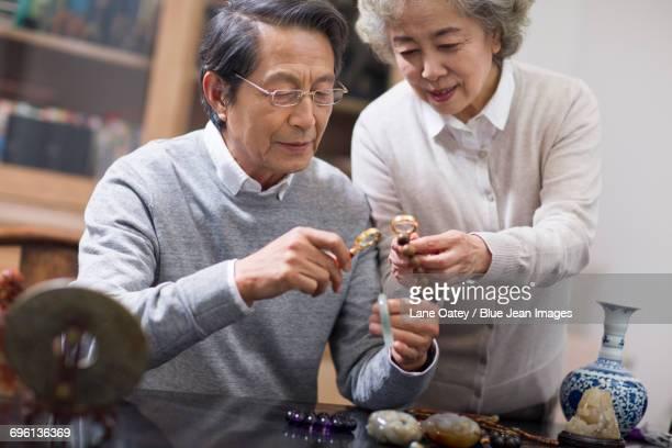 Senior couple admiring antiques