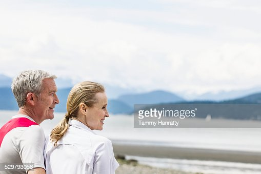 Senior couple admiring view of lake : Bildbanksbilder