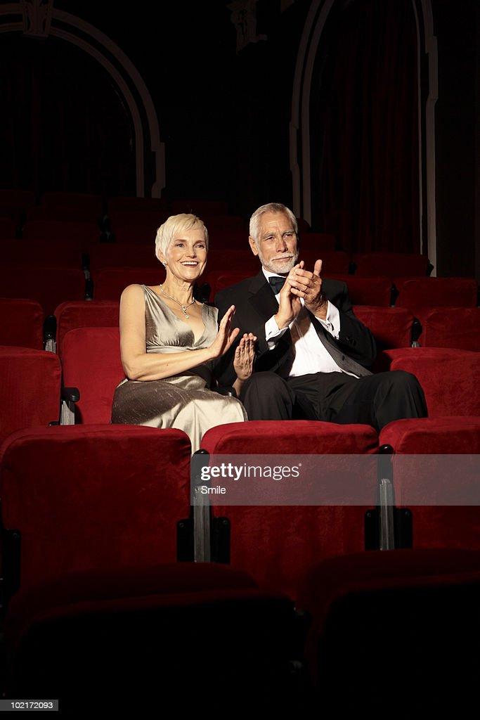 Senior couple applauding in theatre : Stock Photo