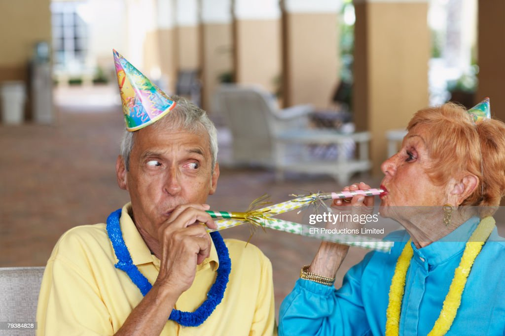 Senior couple at birthday party : Stock Photo