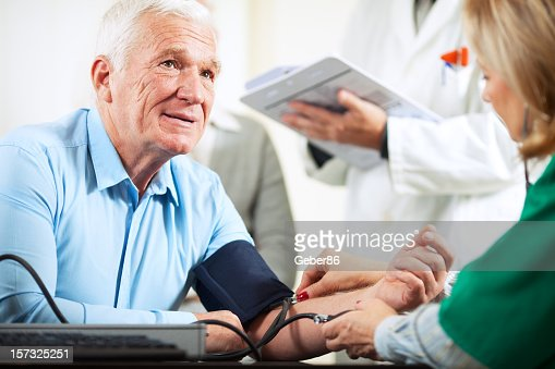 Senior couple at doctor's office : Stock Photo