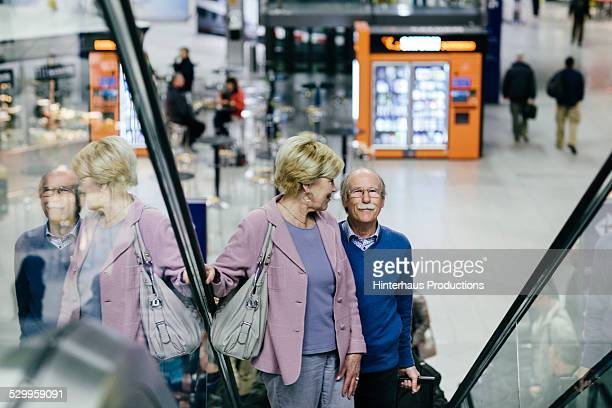 Senior Couple At The Airport