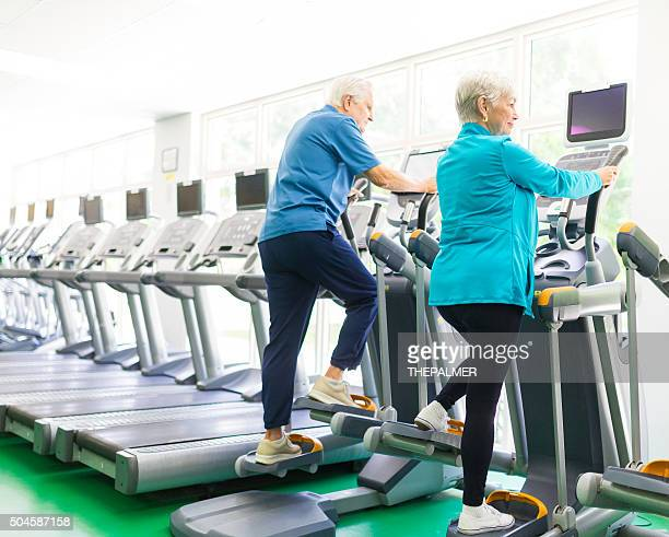 Senior couple at the elliptical machines