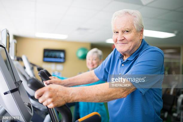 Senior couple at the elliptical machines
