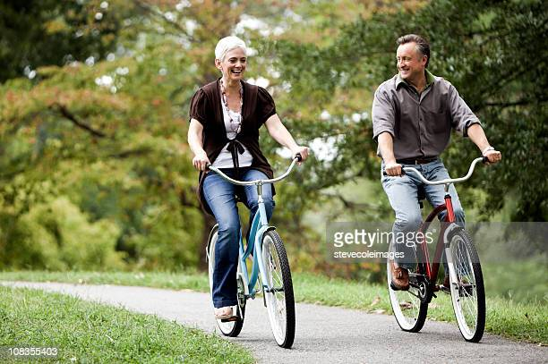 Senior Couple Biking Together in the Park