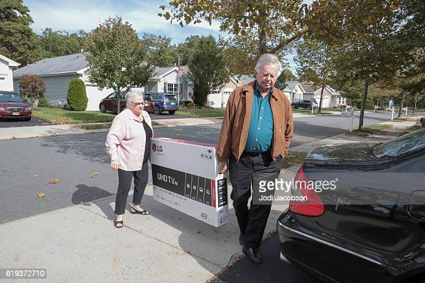 Senior couple bringing home new flat screen television