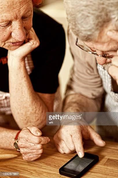 Senior couple browsing on a smart phone