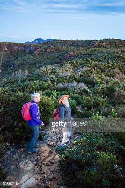Senior Couple Bushwalkers in the Bush With Pre Dawn Light