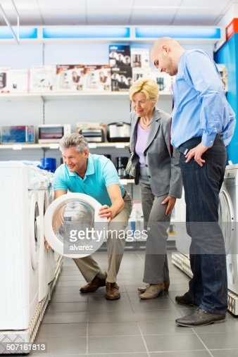 Senior couple buying a washing machine