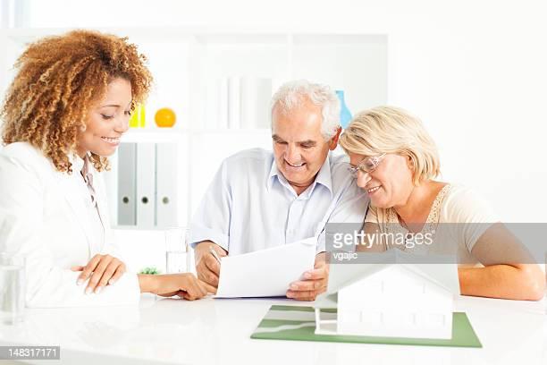 Senior Couple Buying New Home.