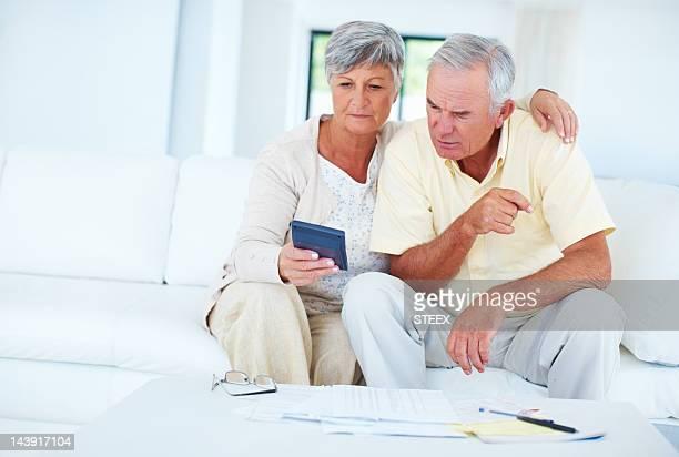 Senior couple calculating home budget