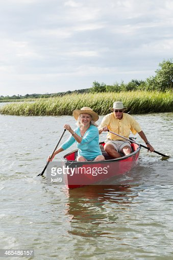 Senior couple canoeing together on Intracoastal waterway