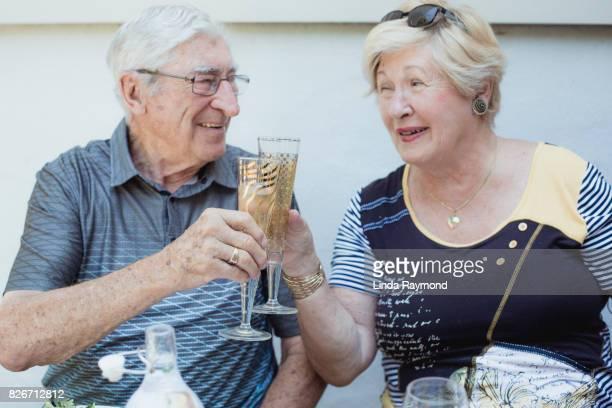 Senior couple celebrating with champagne