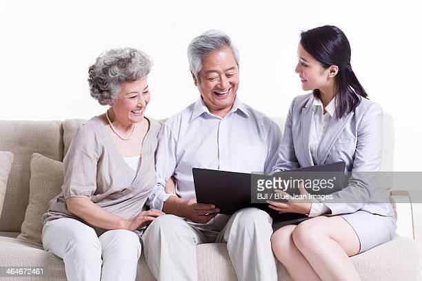 Senior couple chatting with financial advisor