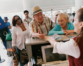 Senior Couple Check In at an Airport