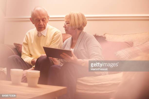 Senior couple checking insurance policy