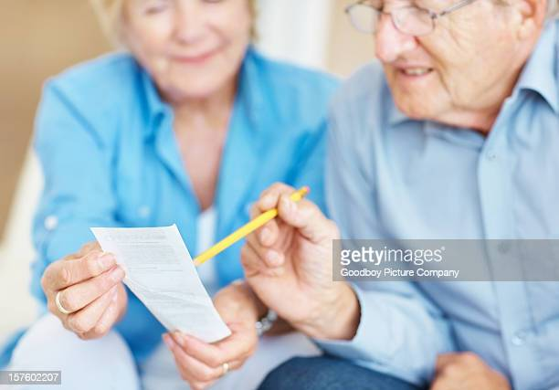 Senior couple checking their accounts at home