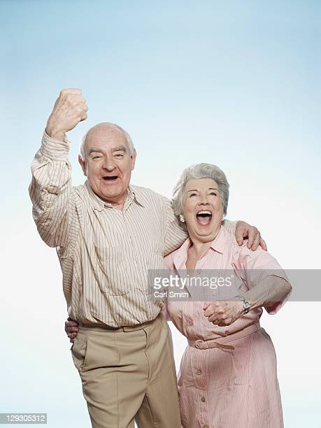 Senior couple cheering