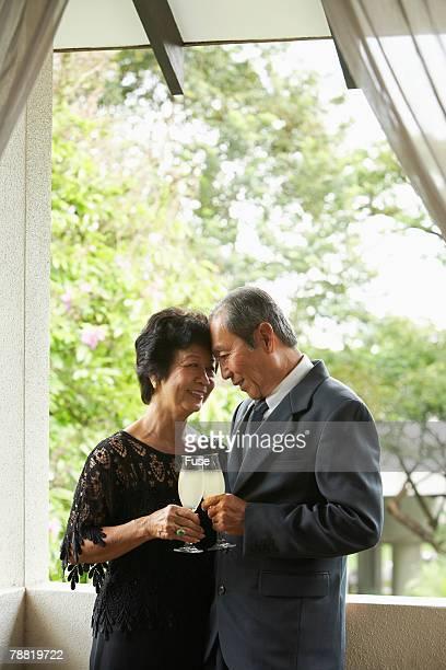 Senior Couple Clinking Champagne Glasses