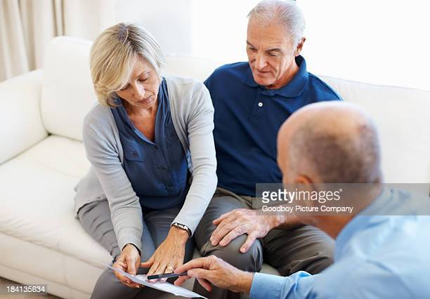 Senior couple consulting with financial advisor