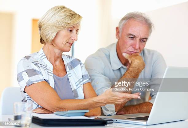 Senior couple conversing about family budget