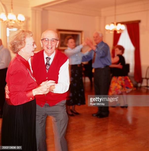 Senior couple dancing in ballroom, portrait