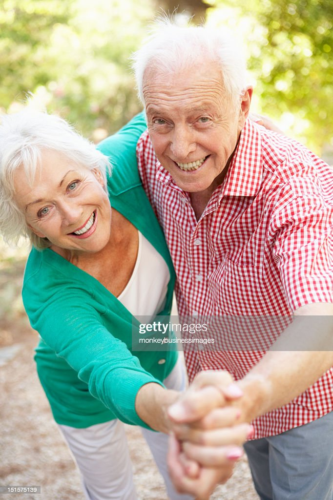 Senior Couple Dancing In Countryside Together : Stock Photo