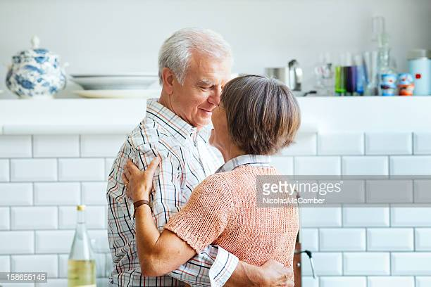 Senior couple dancing in the kitchen