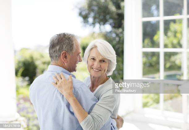 Senior couple dancing on patio