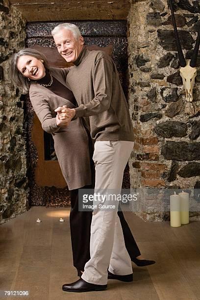 A senior couple dancing