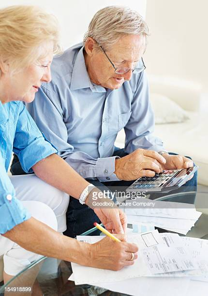 Senior couple discussing their financial budget at home
