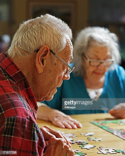 Senior Couple Doing Jigsaw Puzzle Together