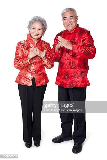 Senior Couple Dressed in Traditional Clothing Celebrating Chinese New Year