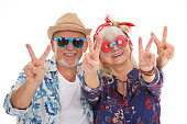 Young at heart - senior couple dressed like a hippie