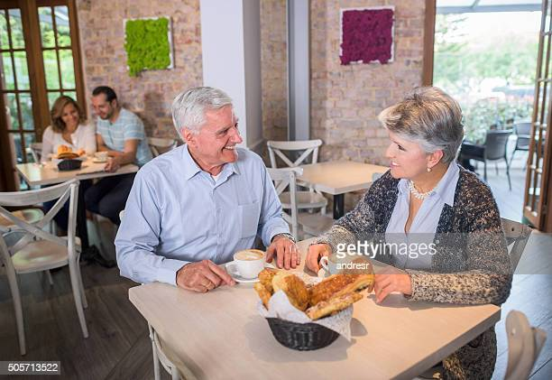 Senior couple drinking coffee at a cafe