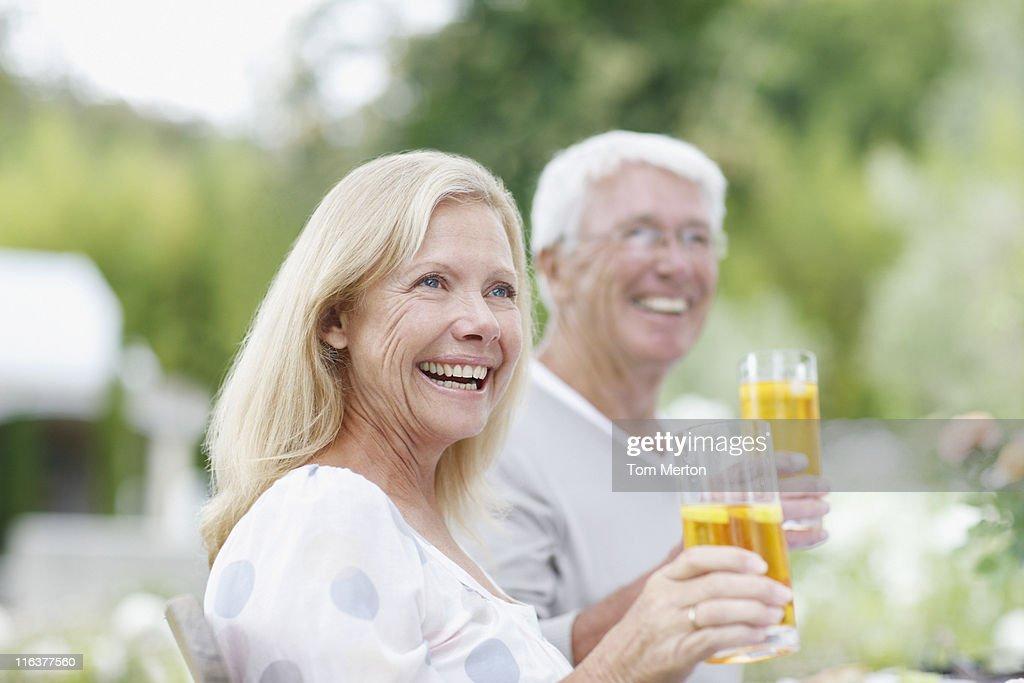 Senior couple drinking iced tea : Stock Photo