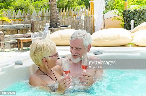 Senior Couple Drinking Wine in Jacuzzi