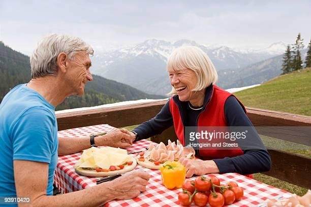 senior couple eating in mountains