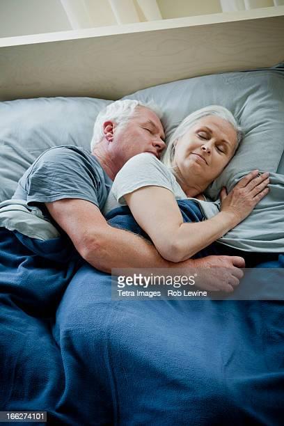 Senior couple embracing and sleeping
