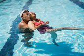 Senior couple embracing in pool