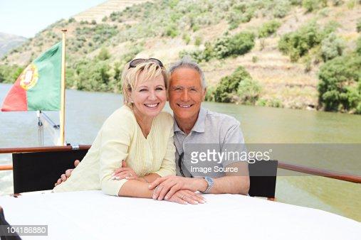 Senior couple enjoying a boat holiday