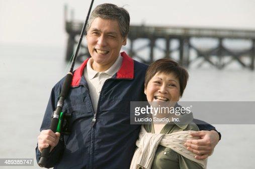 Senior couple enjoying a stroll after fishing stock photo for Senior fishing license