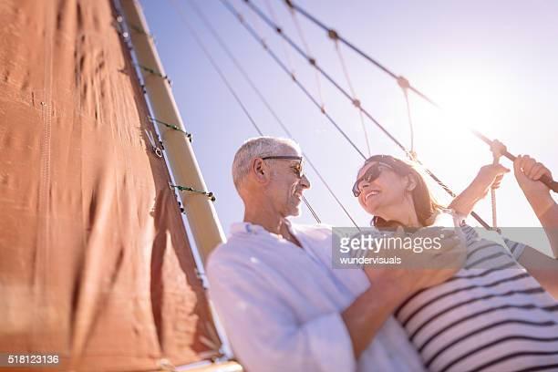 Senior couple enjoying a yacht cruise together with blue sky