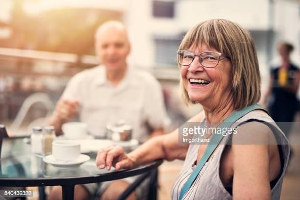 Senior couple enjoying coffee in hotel resort