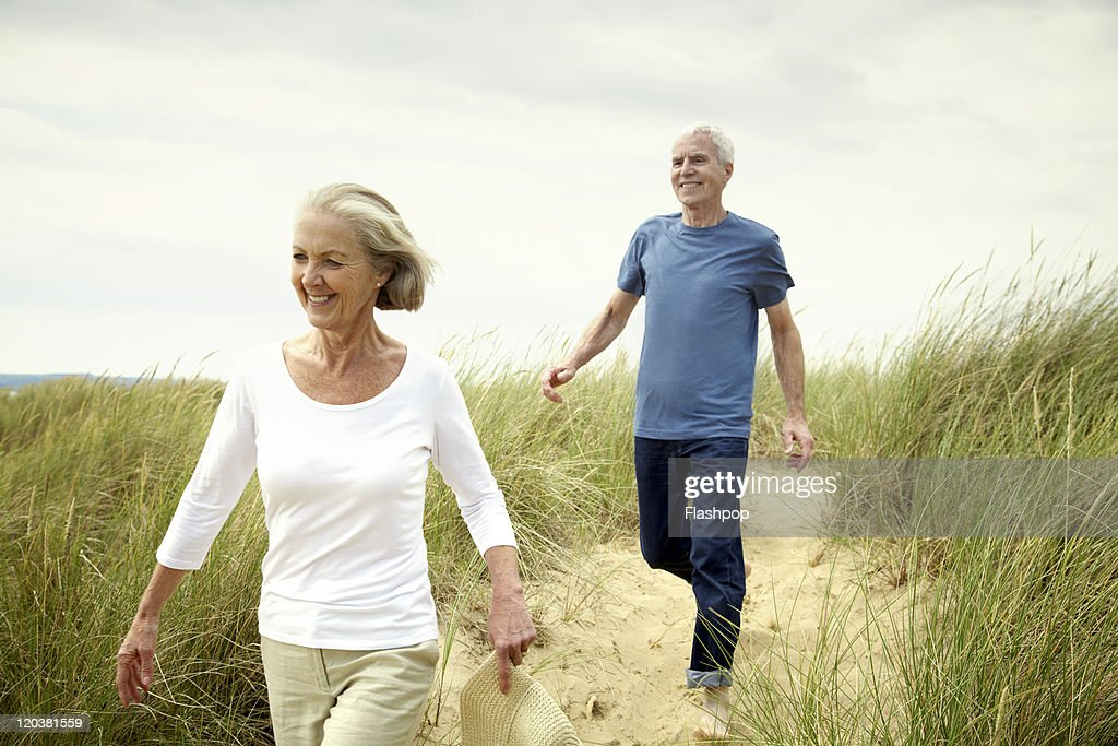 Senior couple enjoying day out at the beach : Stock Photo