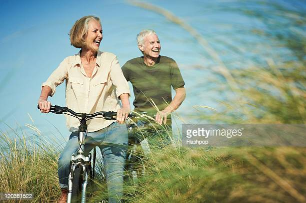 Senior couple enjoying day out on their bicycles