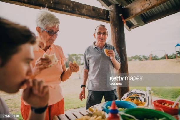 Senior Couple Enjoying Food at a BBQ