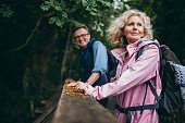 Senior Couple enjoying hike in the forest at the weekend